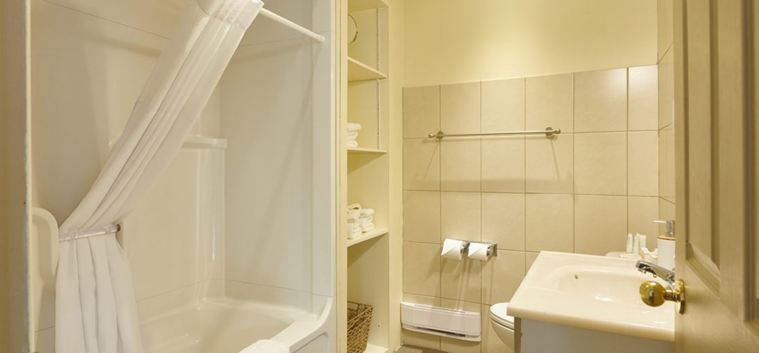 A view of the bathroom, adoring white and cream coloured walls in Room 201