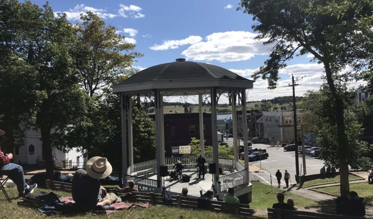 spectators watching live music performed in a gazebo