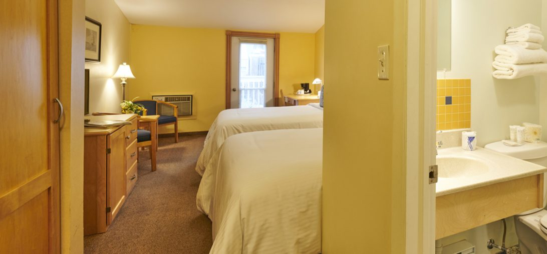 A view of the Bathroom and Beds from the door of Room 304.