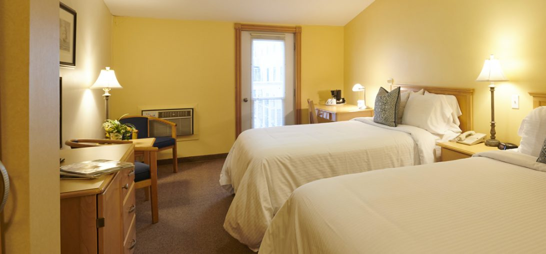 Double beds with a vew of the balcony door in room 304