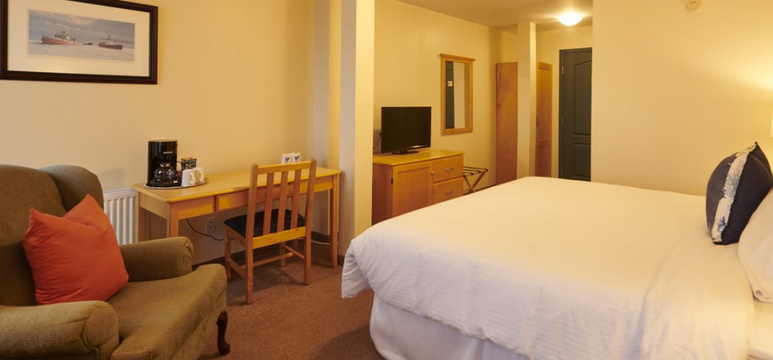 view of the writing desk as well as the King sized bed in room 301